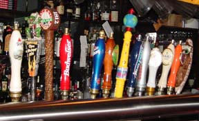 Taps at the Dinosaur Bar-B-Que include the house brew, made by Middle Ages Brewing of Syracuse, photo by Lucy Saunders